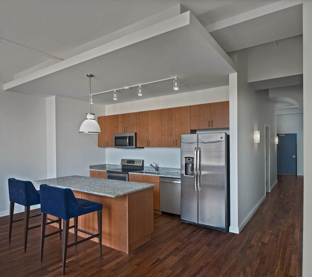 A picture of a kitchen in an apartment