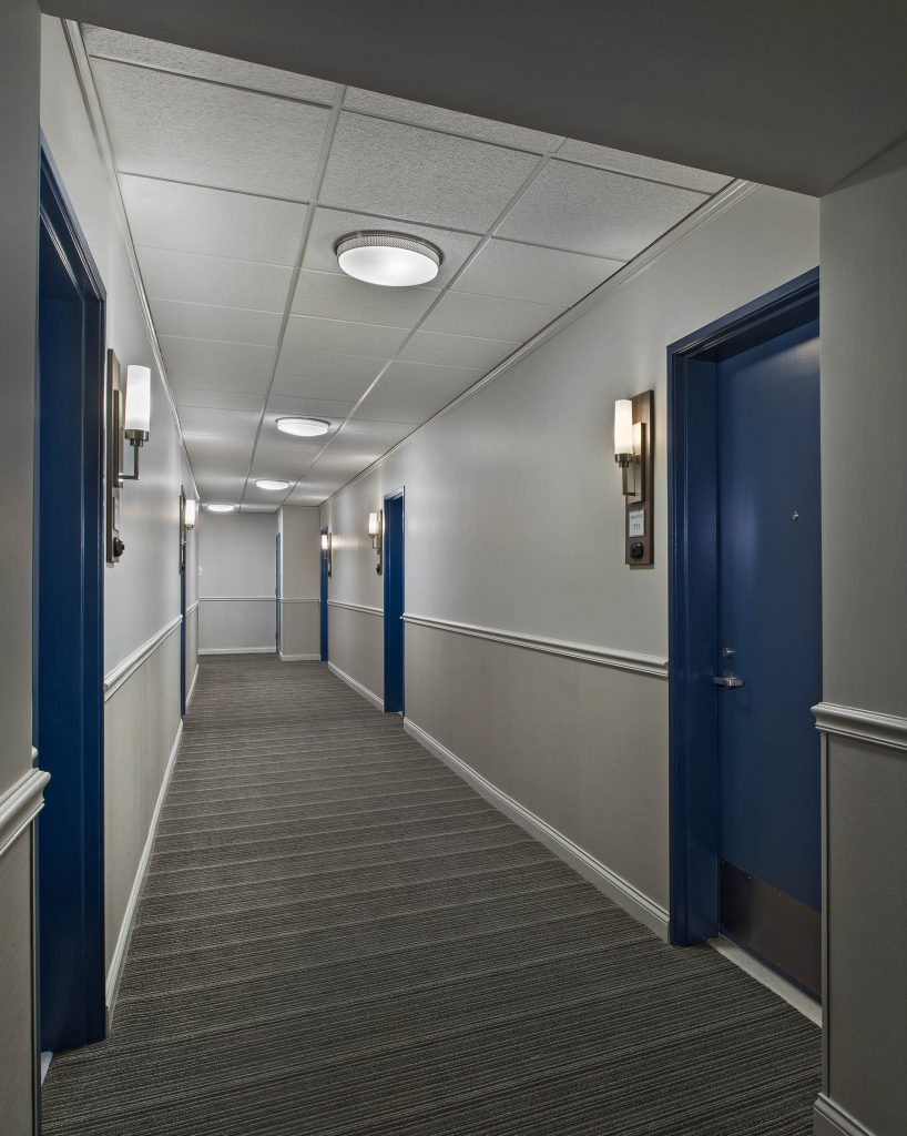 A picture of a hallway in an apartment building