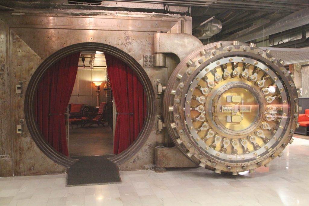 A picture looking into a large metal bank vault