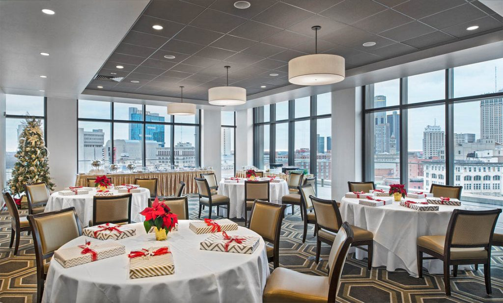 A picture of a room with windowed walls and banquet tables and chairs