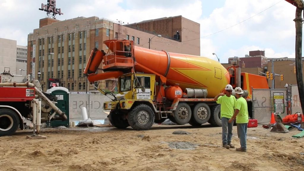 A picture of people working to pour cement