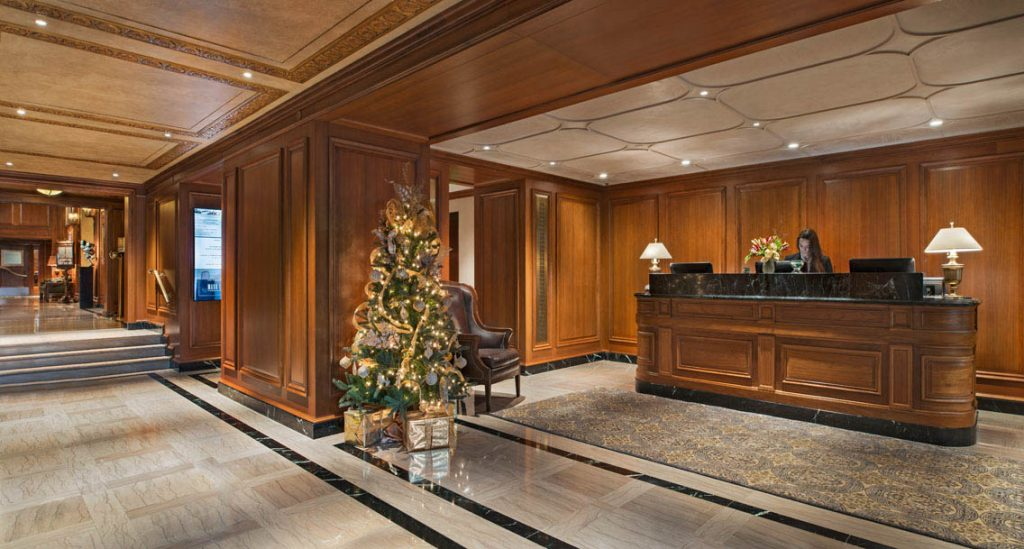 A picture of a wooden room with a lobby area