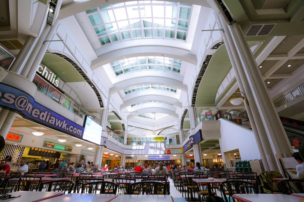 A photo of the interior side of a roof inside of a mall