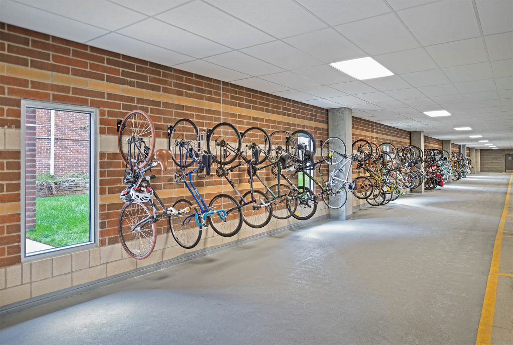 A picture of bikes hanging on a brick wall